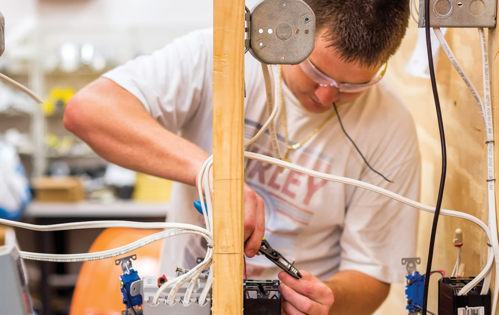 A student completes a wiring task at Locklin Technical College