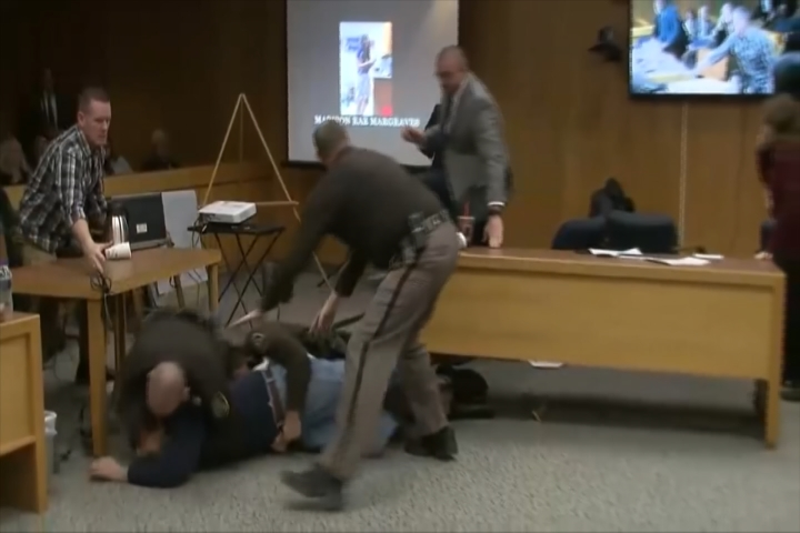 Nassar listening to halted as father lunges at disgraced physician