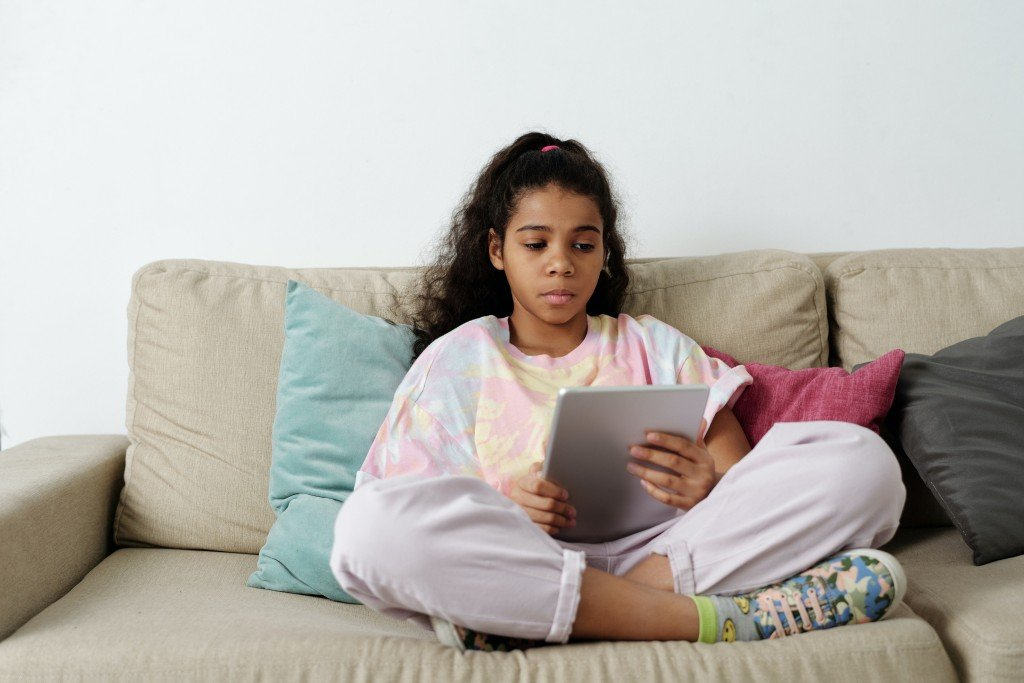 Girl In Pink Shirt Sitting On Couch 4144042