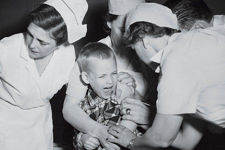 McLean student Robert Henninger receives the polio vaccine in 1954.