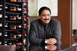 Rasika's tandoor virtuoso Vikram Sunderam peruses the wine cellar at 2941. It's one of his favorite spots close to home. Photo by Jonathan Timmes