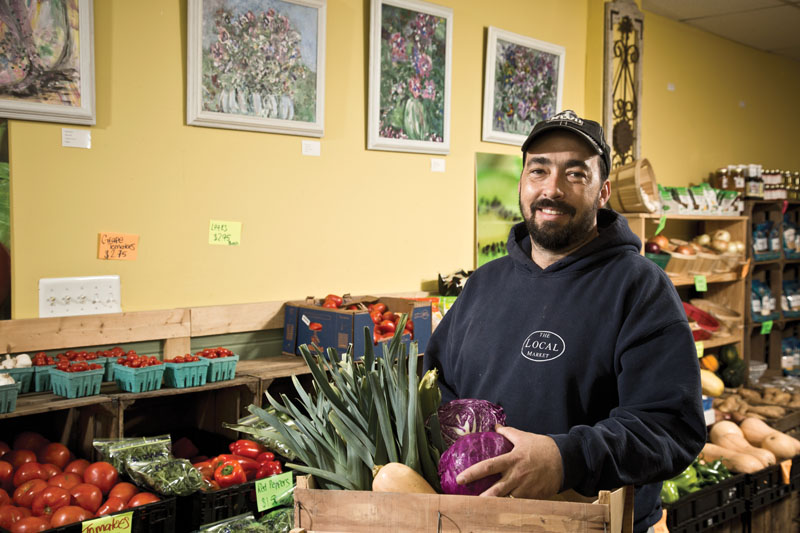 Tom Coates, owner of The Local Market in Falls Church, sells fresh produce, meats, organic dairy products and specialty items from area farms and food entrepreneurs. Photo by  Benjamin C. Tankersley