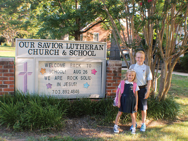 Patty Collins' kids in front of Our Savior Lutheran School in Arlington,  Courtesy Photo