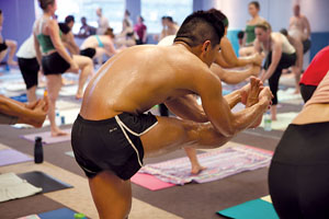 "Bikram, or ""hot"" yoga is practiced in a heated studio to loosen the muscles and detox the body.  Photo by Huguette Roe"