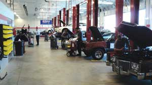 Interior of Strongsville shop shows well-lighted, spacious work bays that provide a great work environment for techs.