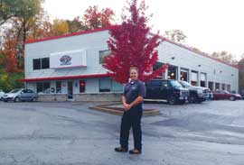 James Copeland stands in front of Midwest Autoworx's recently opened second location in Columbia, Mo. The first shop (inset photo) is located in nearby Boonville, Mo.