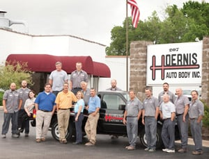 The Hoernis Auto Body team includes, from left: (in the bed of the truck and in the back row behind the truck) Terry Seper, Dustin Gross, Mike Hoernis, Dave Voellinger and Matt Ballard. The front row includes, from left: Bill May, Steve Smith, Megan Kawalec, J. J. Kramer, Steve Hoernis, Debbie Kruep, Russ Hoernis, Charlie Jung, Jeremy Guthrie, Mark Komoromi, Dave Feld and Bill Rappolee.
