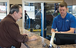 Service Adviser Ron Taskey, right, helps Ron Weiss, a longtime customer.
