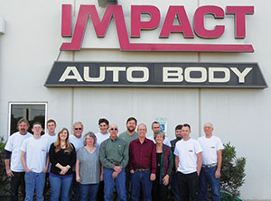 Impact Auto Body's team includes (back row, from left): David Crouch, Kyle Stockton, Mike Dickes, Mike Metcalfe, Tim Van De Grift, Thomas Phillips, Levi Fouch and Gary Geranen; and (front row, from left) Scott Pahl, Whitney Jones, Ida Williams, Tom Butka, Bob Schubert, Debbie Schubert and Jerod Kirk.