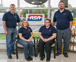 The Village Tire and Auto Repair team includes (from left) Keith Heilveil, owner; Tami Heilveil, office manager; Kay Figart, service adviser; and Sean Greene, ASE master technician.