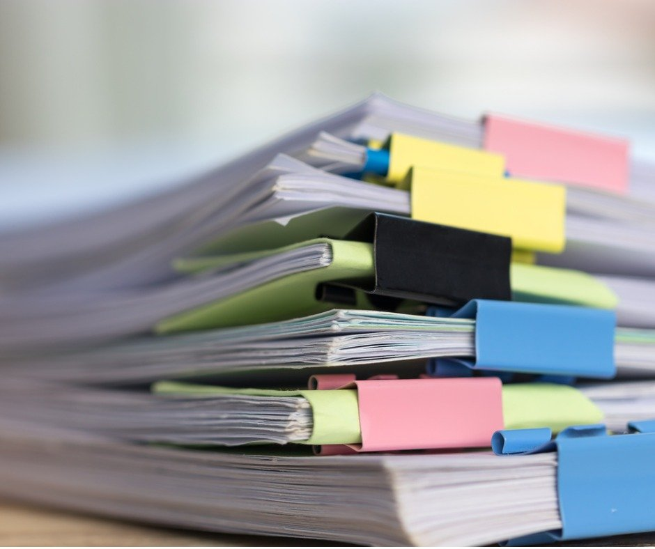 Close Up Stack Of Paperwork Pile Of Unfinished Homework Assignment Picture Id1132040786 (1)