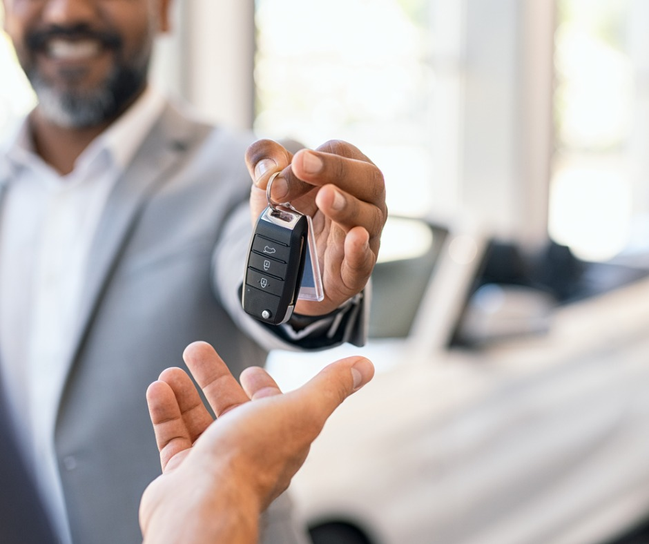 Salesman Giving New Car Keys To Customer Picture Id1138560072
