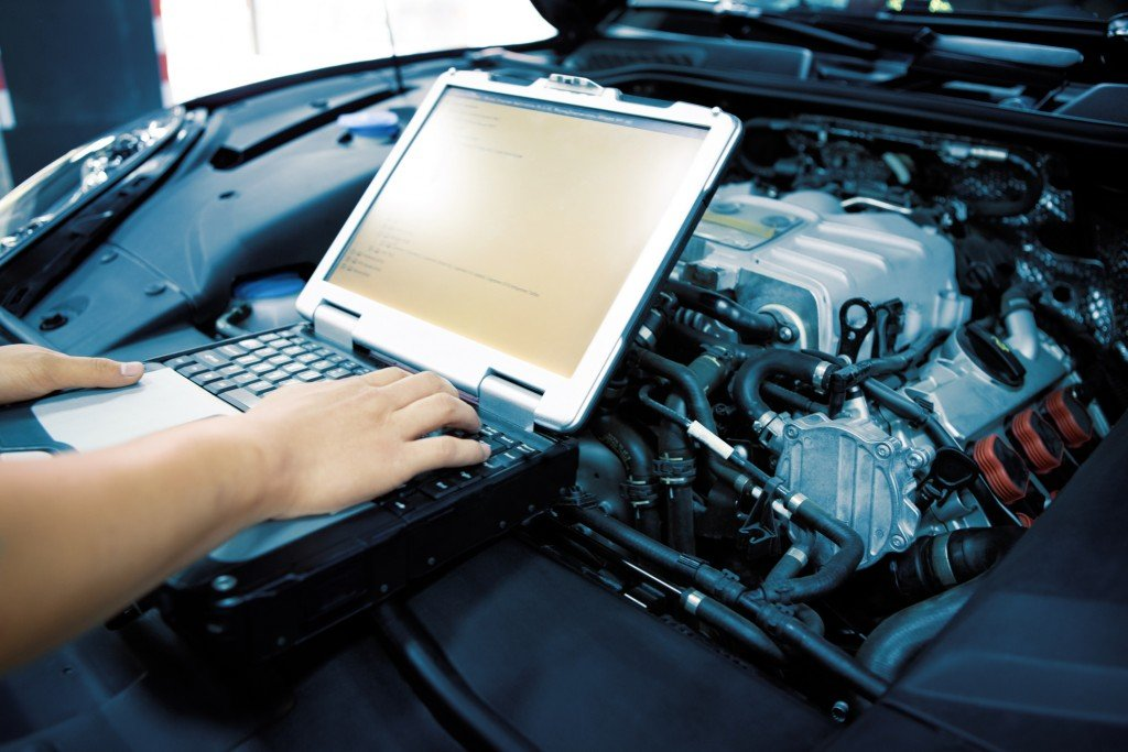 Mechanic Using Diagnostic Machine Tools For Car