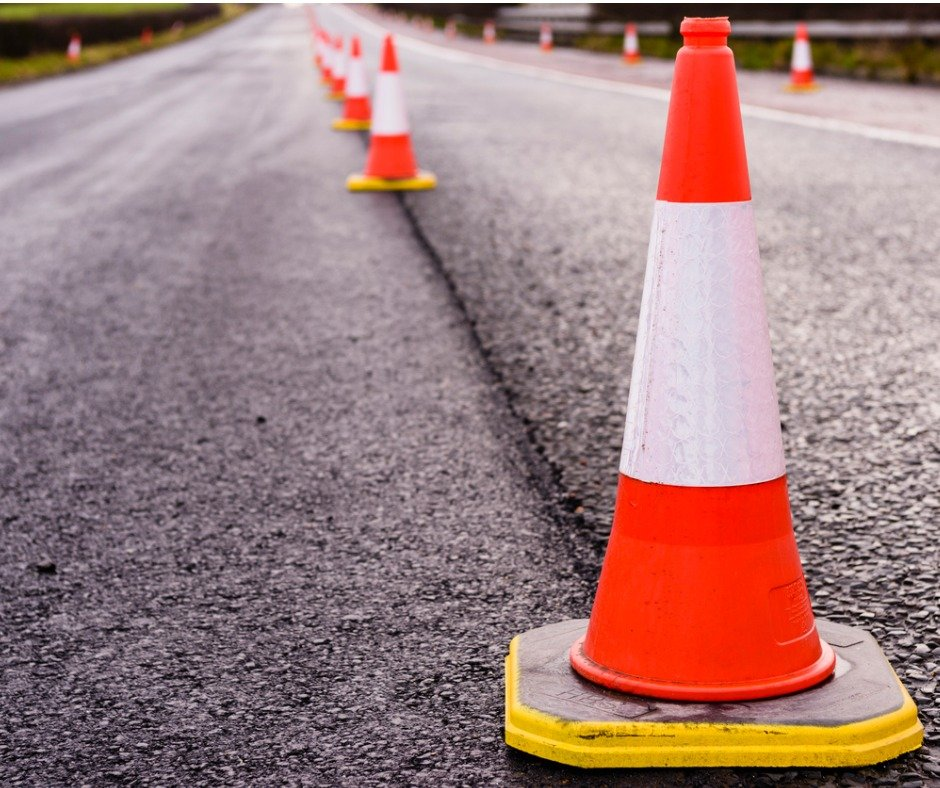 Row Of Traffic Cones Along The Middle Of A Road Being Resurfaced Picture Id967772956