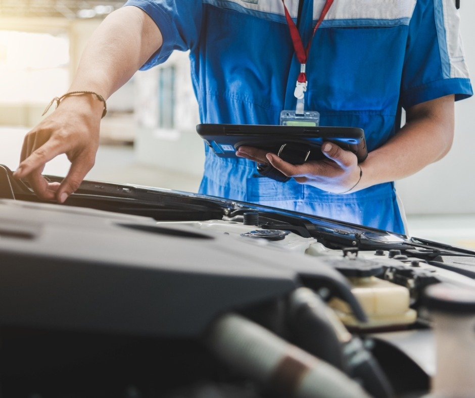 Auto Mechanic Uses The Tablet To Check Picture Id1137474295