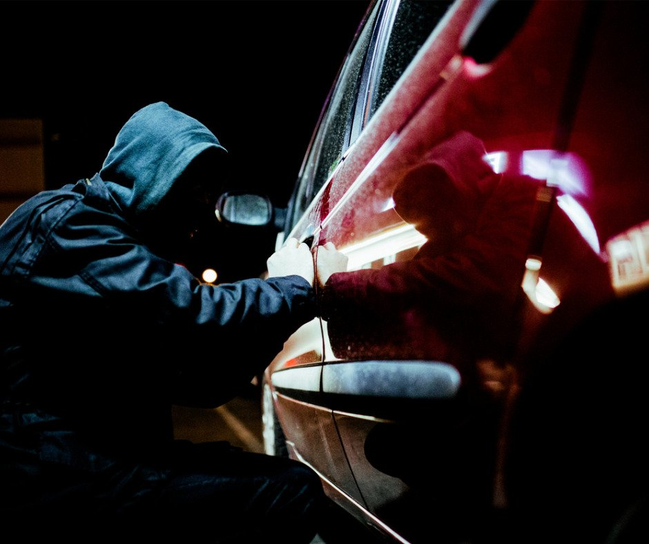 Man Stealing A Car Picture Id610780046