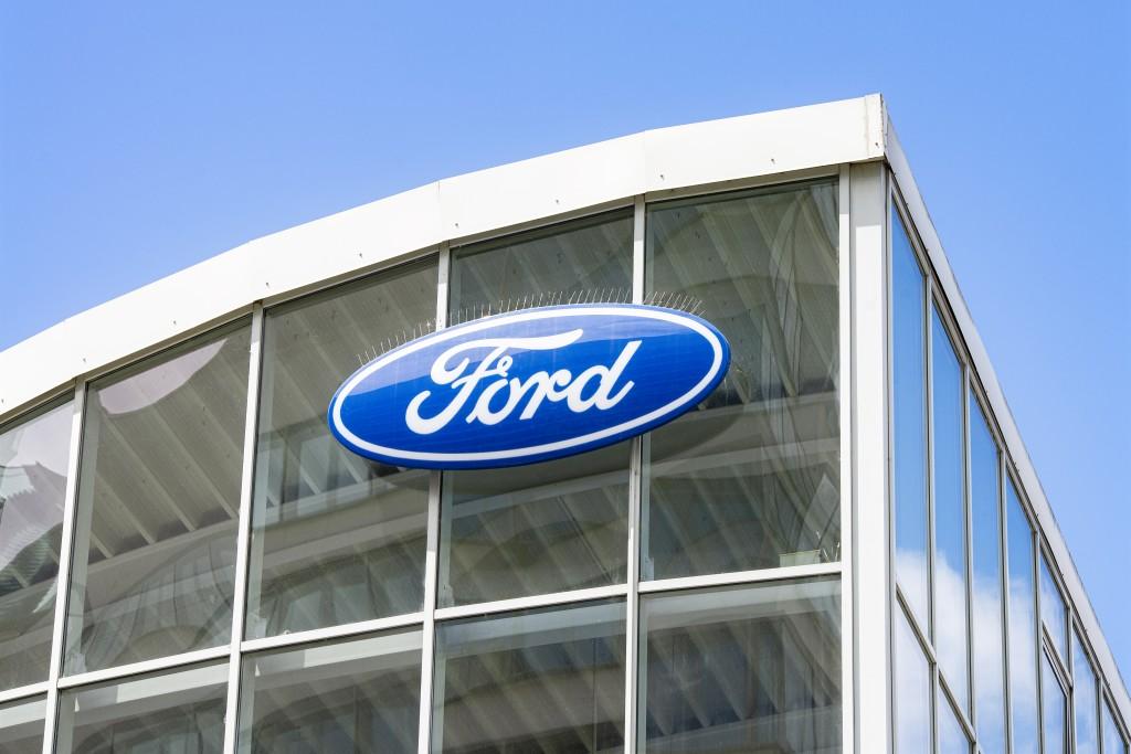 Logo Of Ford At A Car Dealership