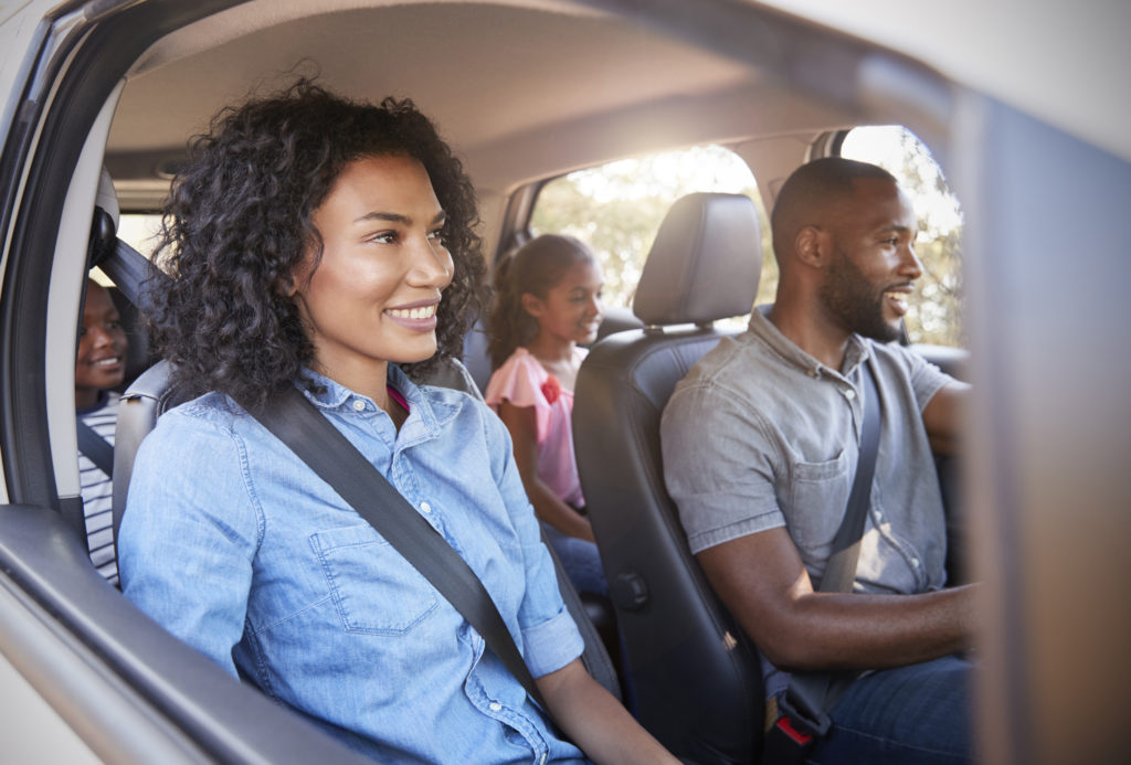 Young Black Family With Children In A Car Going On Road Trip
