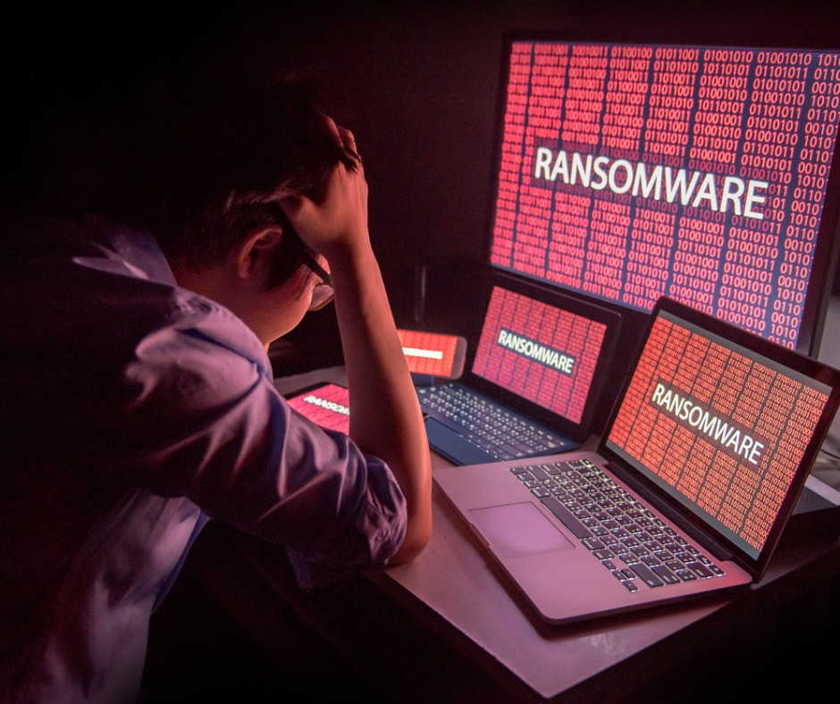 Young Asian Male Frustrated By Ransomware Cyber Attack Picture Id845470768