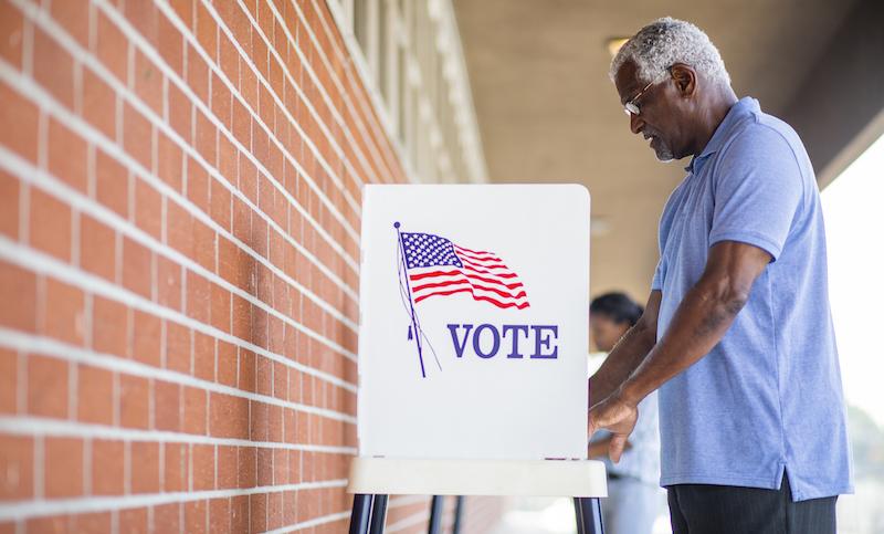 Senior Black Man Voting