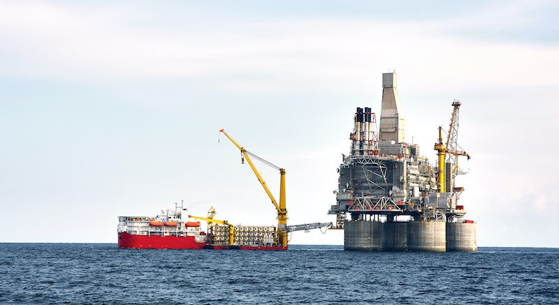 Drilling Rig And Support Vessel On Offshore Area