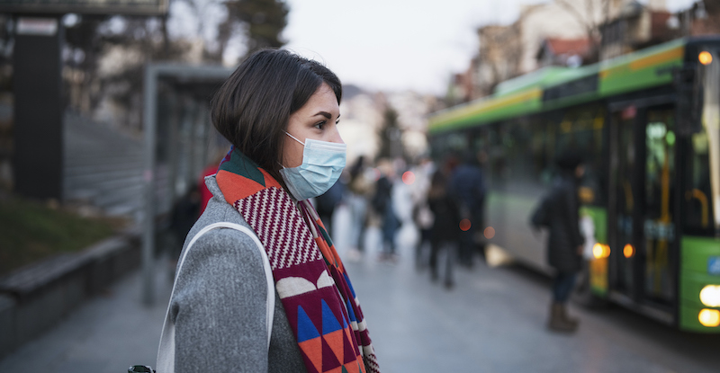 Woman In Town Wearing Protective Face Mask.