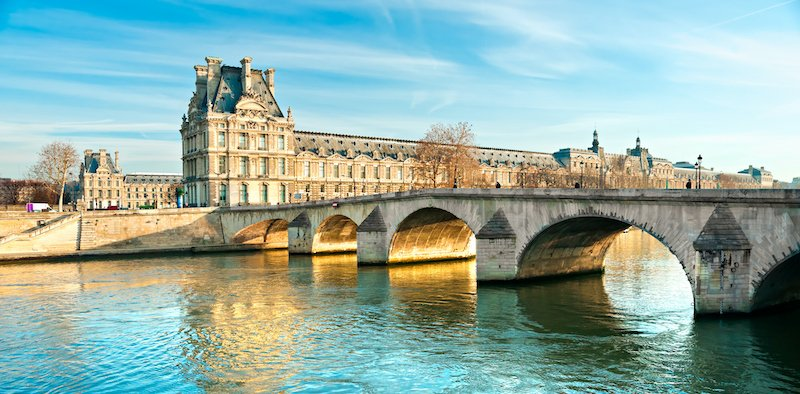 Pont Royal And Louvre Museum In Paris, France