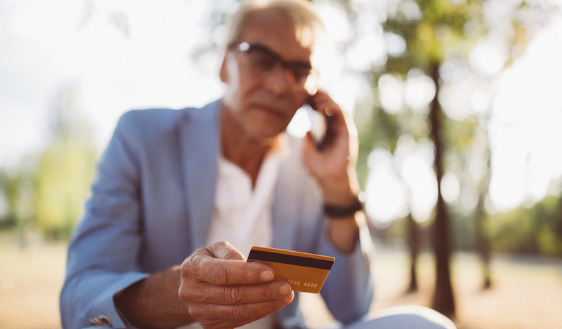 Senior Man Having Problems With Credit Card Phoning The Bank