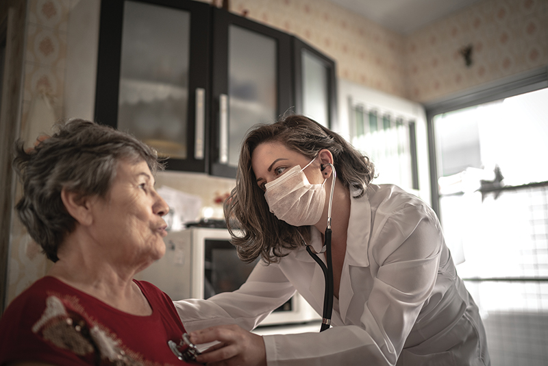 Health Visitor And A Senior Woman During Home Visit