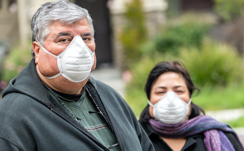 Overweight Senior Couple Wearing A N95 Protective Mask Due Covid 19 Pandemic