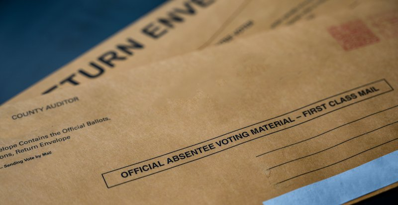 Selective Focus On Brown Official Absentee Ballot Voting Material Envelope