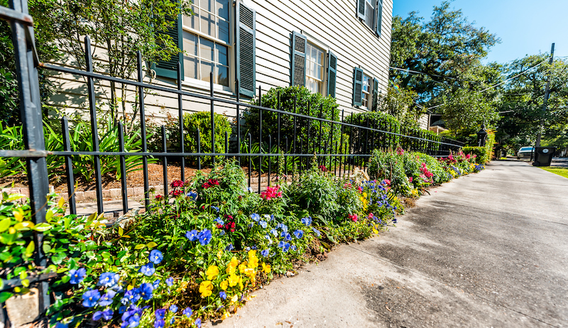 New Orleans, Usa Old Historic Garden District In Louisiana Famous Town City Sidewalk Street With Real Estate Historic Houses Flowers Landscaped