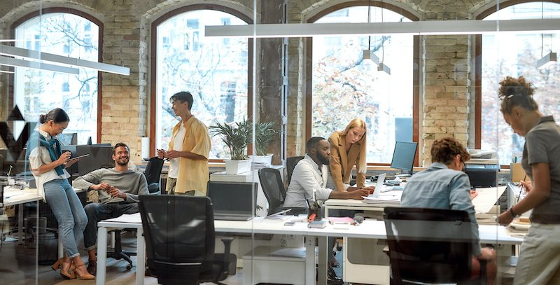Successful Team At Work. Group Of Mixed Race Business People Working Together In The Creative Office