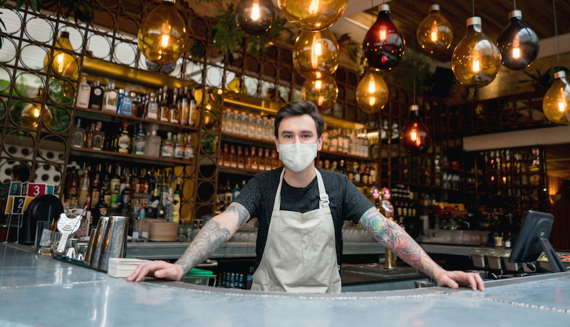 Happy Bartender Working At A Bar Wearing A Facemask