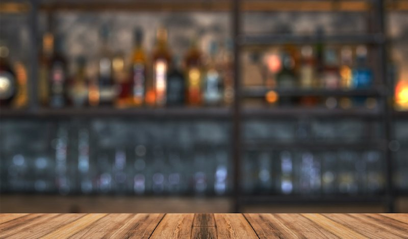 Bar With Blurred Lights Bokeh And Wooden Table Bar With Blurred Lights Bokeh And Wooden Table