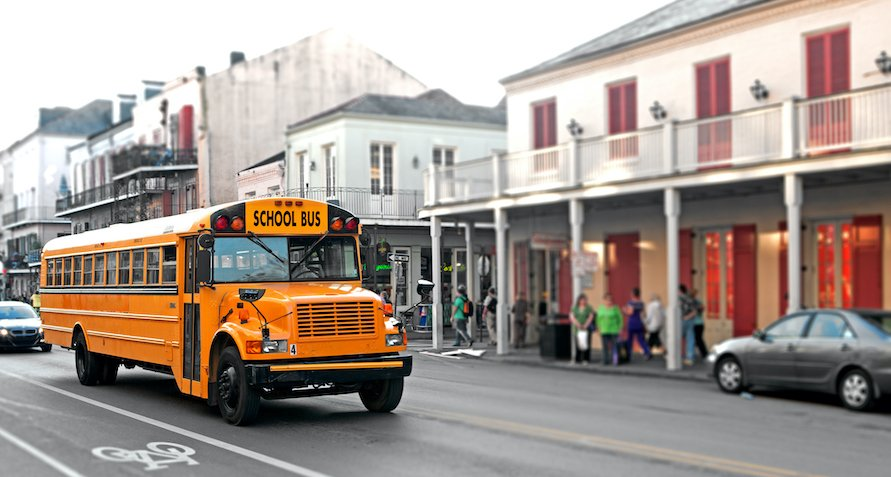 School Bus Driving Through The City