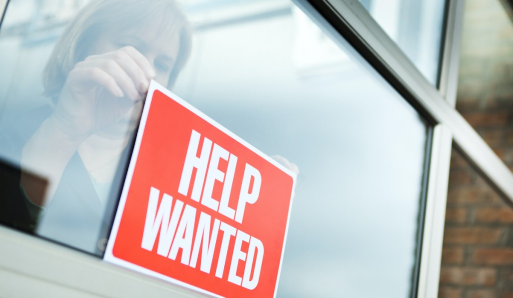 Help Wanted Recruitment Sign Displayed For Hiring, Employment, Economic Recovery