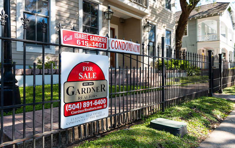 Real Estate For Sale Sign By Realtor Of Apartment Condominium In Garden District, New Orleans