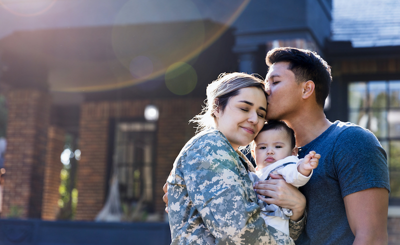 Mid Adult Man Kisses His Soldier Wife