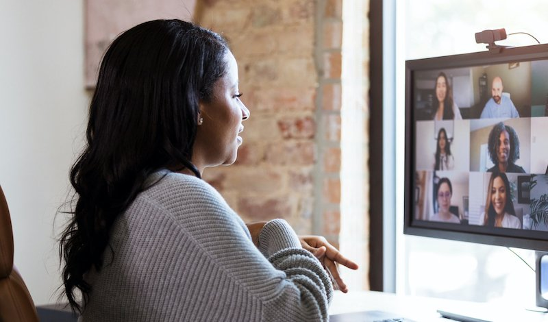 Working From Home, Woman Meets With Colleagues Via Video Conference