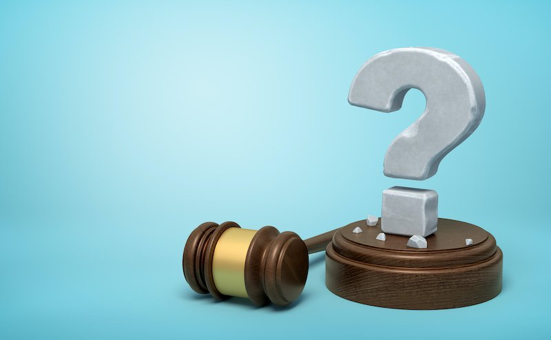 3d Rendering Of Hefty Stone Question Mark Standing On Sounding Block With Gavel Beside On Light Blue Background With Copy Space.