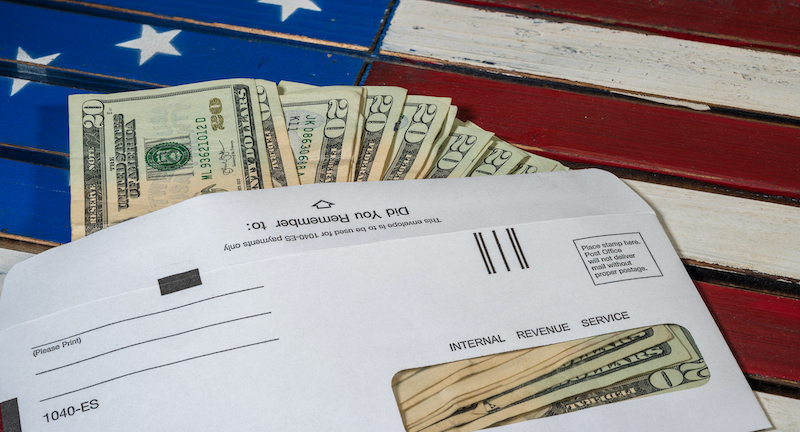 Illustration Of The Federal Stimulus Payment From The Irs Paid In Cash On Us Flag