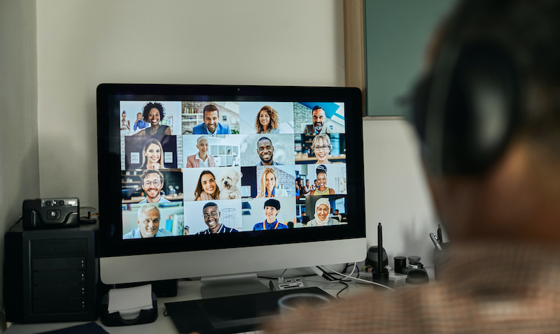 Businessman Working With Colleague Through Video Conferencing