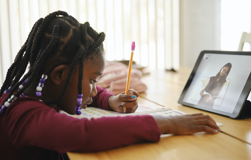 An Elementary School Student Working At Home