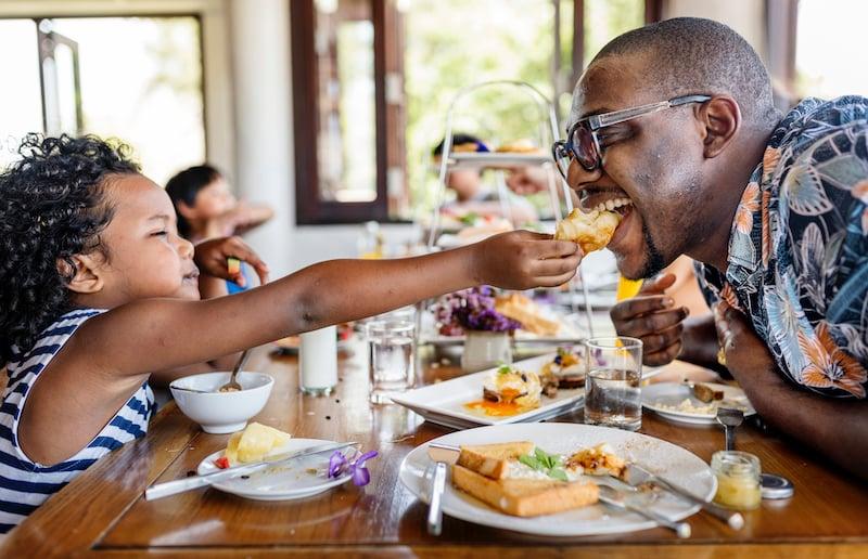 Guests Having Breakfast At Hotel Restaurant