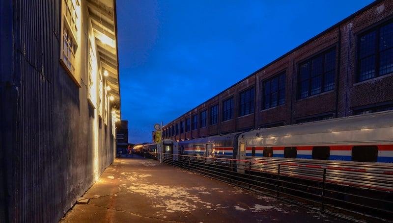 Old Railroad Buildings, Amtrak Train And Platform