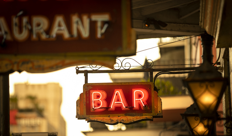 Neon Bar Sign Hangs From A Drinking Establishment