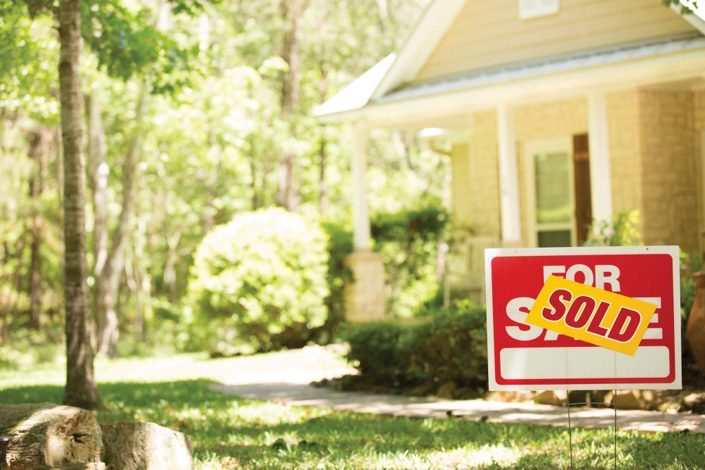 Home For Sale With Real Estate Sign.