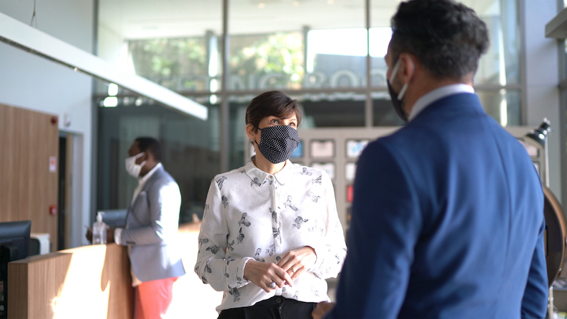 Coworkers Talking On Office's Lobby With Face Mask