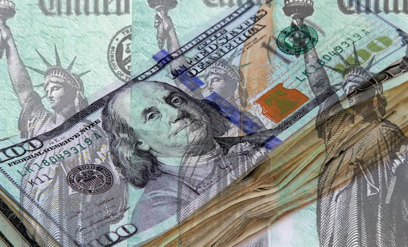 Federal Treasury Checks Over Stack Of Us Currency
